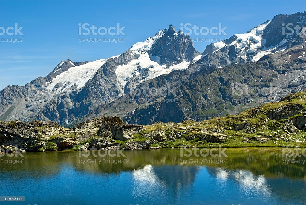 mountain lake and La Meije (France) stock photo