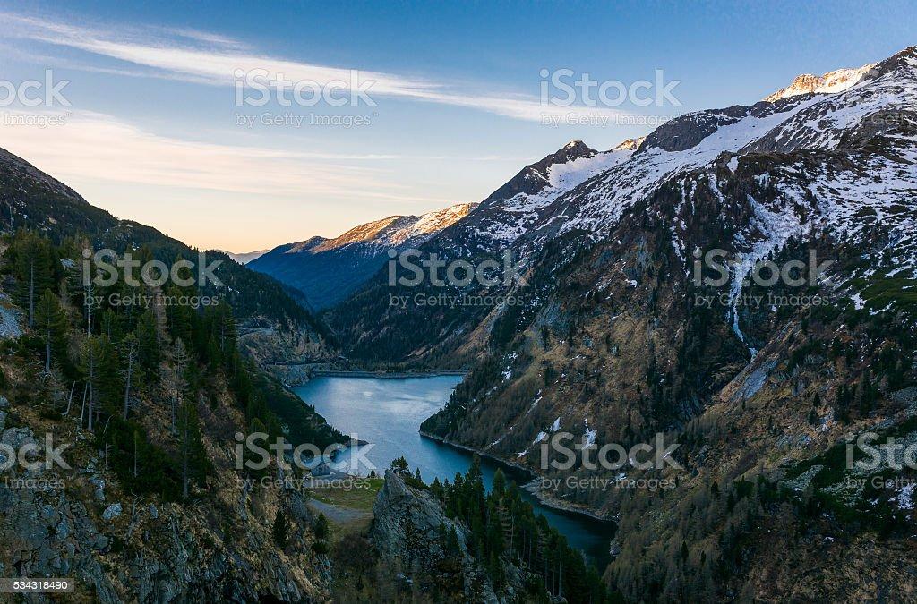 Mountain lake at dusk. stock photo