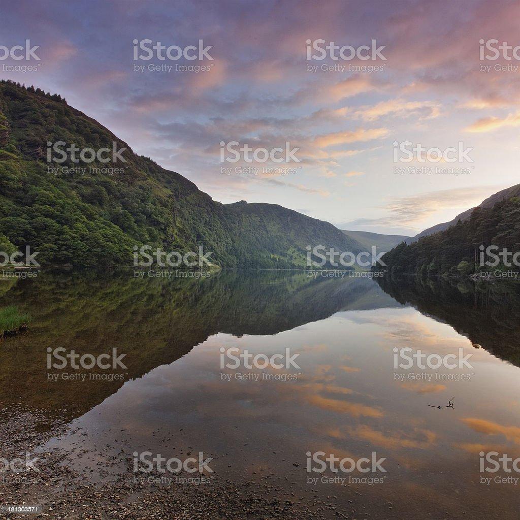 mountain lake at sunset stock photo