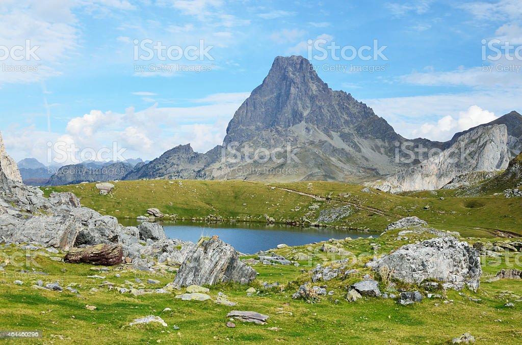 Mountain lake Casterau against the peak du Midi d'Ossau stock photo