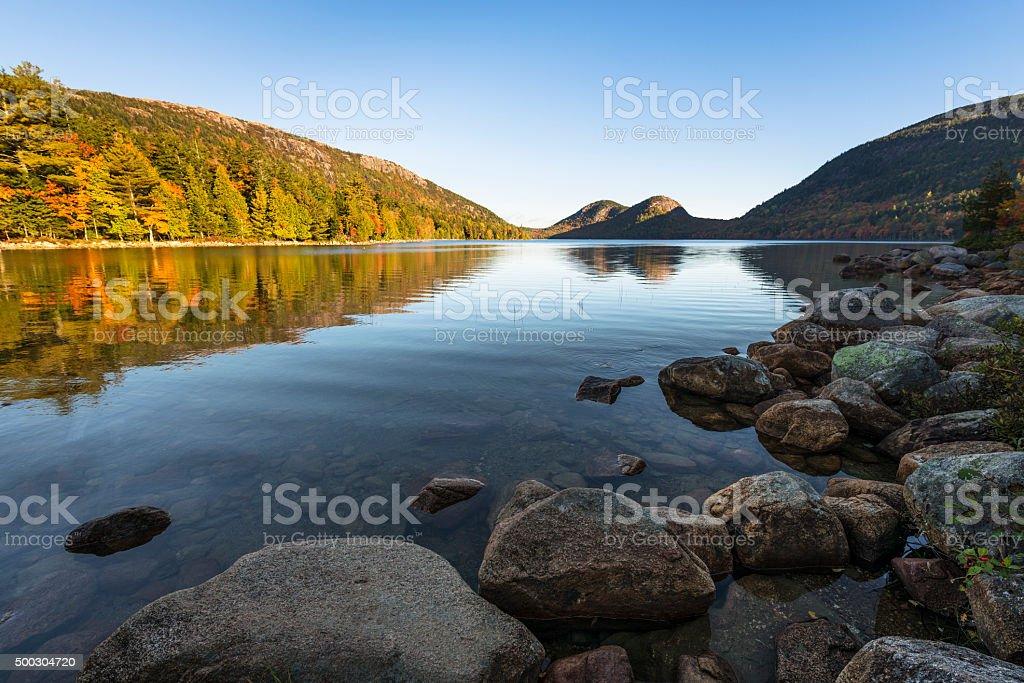 Mountain Lake in Early Autumn Sunlight stock photo