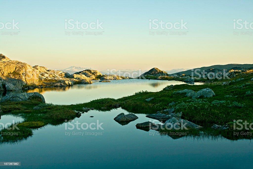Mountain lake in midnight sun royalty-free stock photo