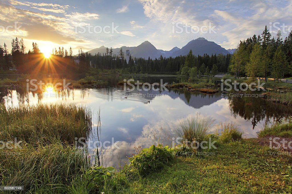 Mountain lake in Slovakia at sunset - Strbske pleso stock photo