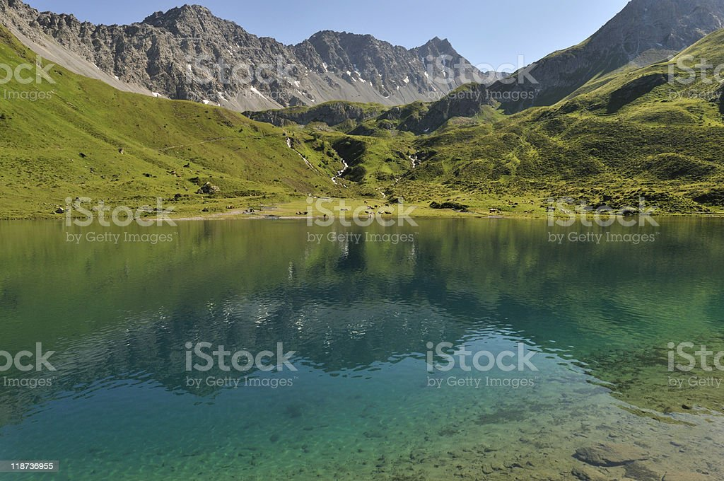 mountain lake in the Swiss Alps stock photo