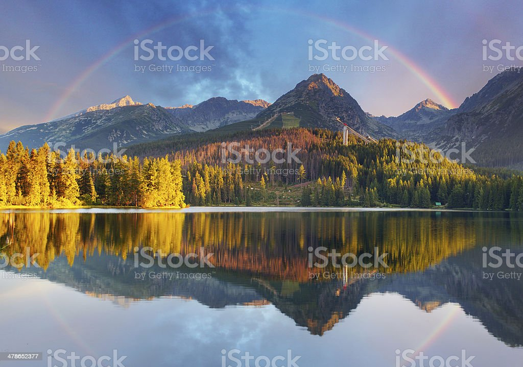 Mountain lake landscape with rainbow - Slovakia, Strbske pleso stock photo
