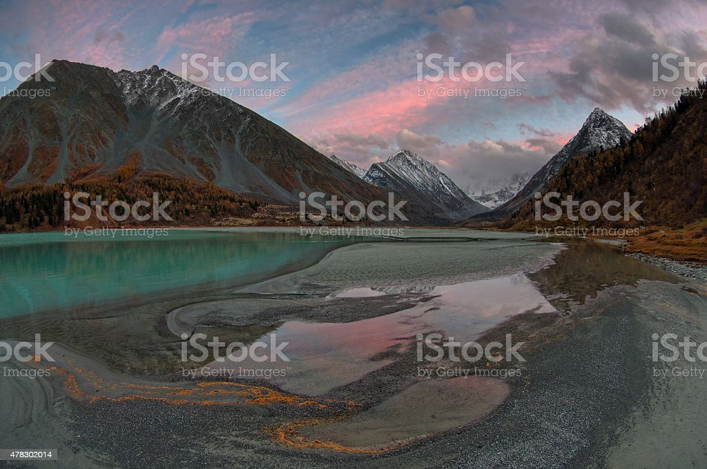 Mountain lake on the background of snowy peaks in autumn stock photo