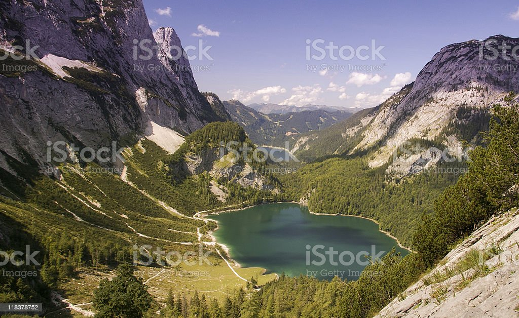 Mountain lake surrounded by forrest and limestone walls royalty-free stock photo