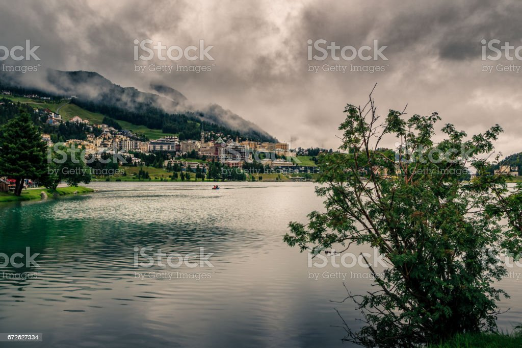 Mountain lake under heavy clouds stock photo