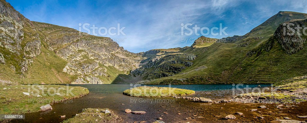 Mountain lake with a small island stock photo