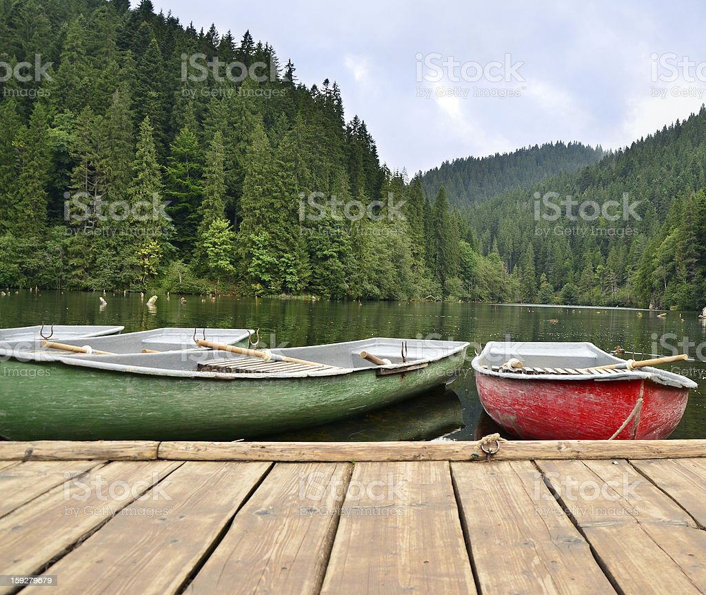 Mountain lake with boats royalty-free stock photo