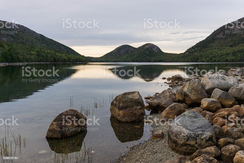 Mountain lake with forest and hills stock photo
