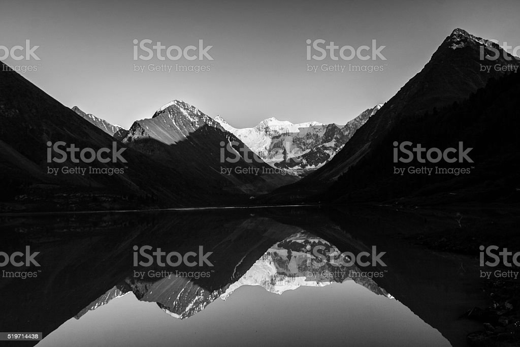 Mountain lake with reflections BW stock photo