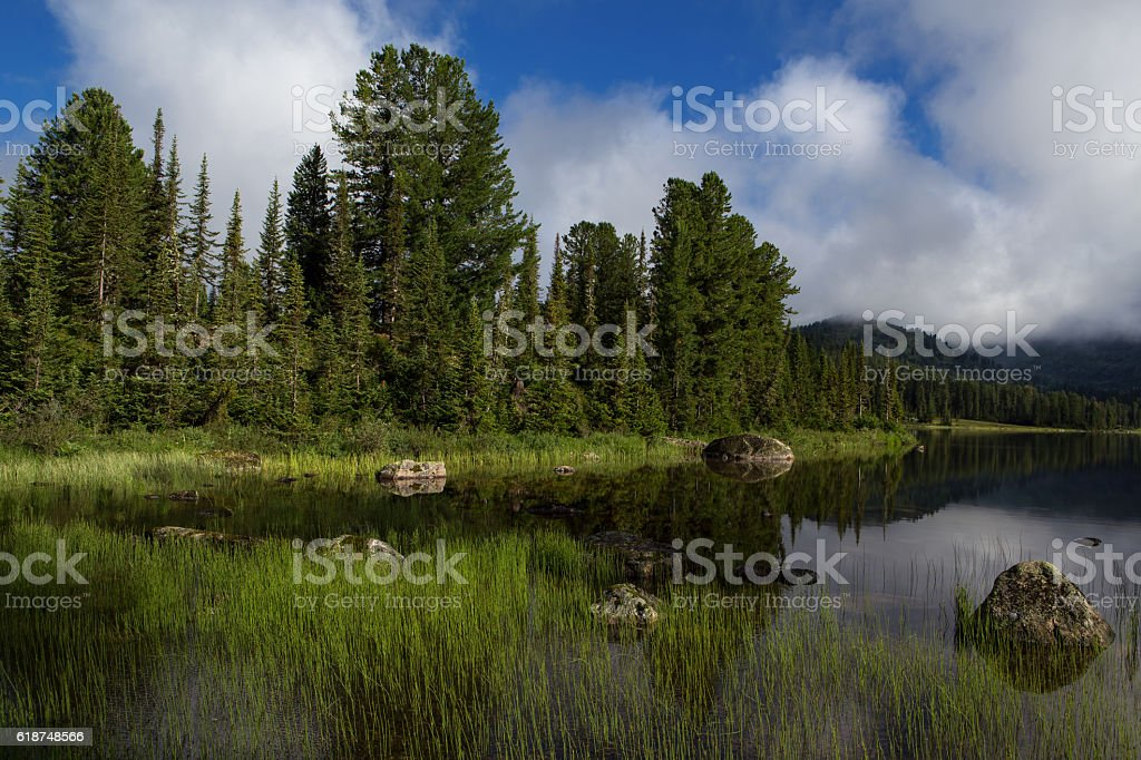 Mountain Lake with rocks in the foreground. stock photo