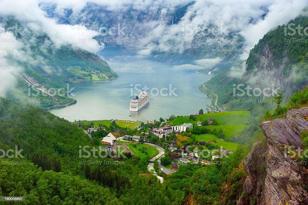 Mountain lake with ship stock photo