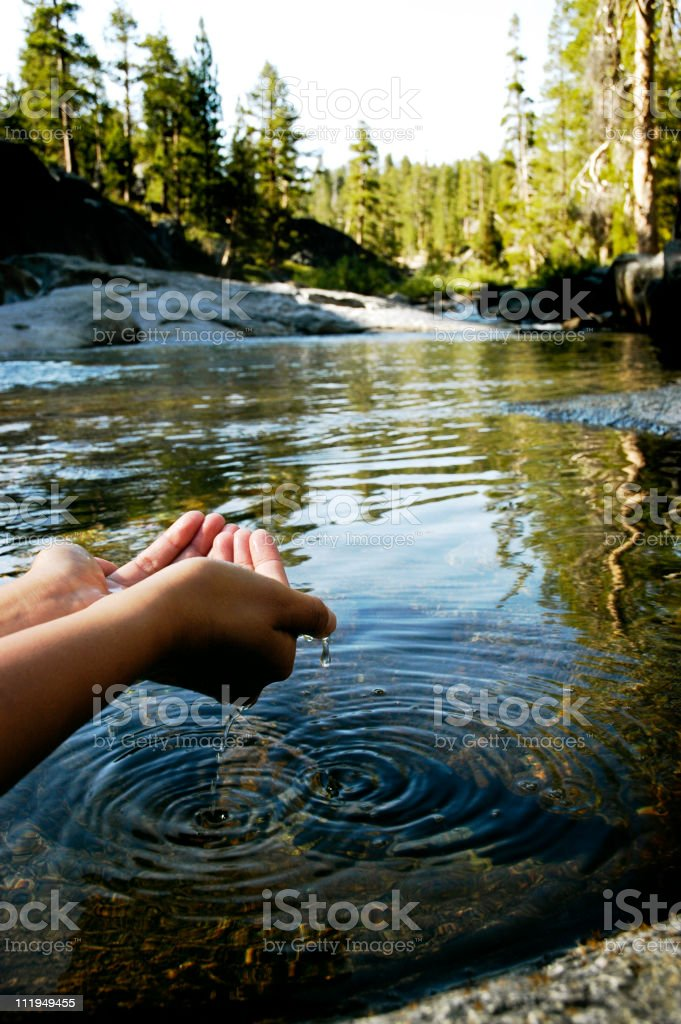 Mountain Lake with Woman's Hands Cupping Water Yosemite National Park royalty-free stock photo