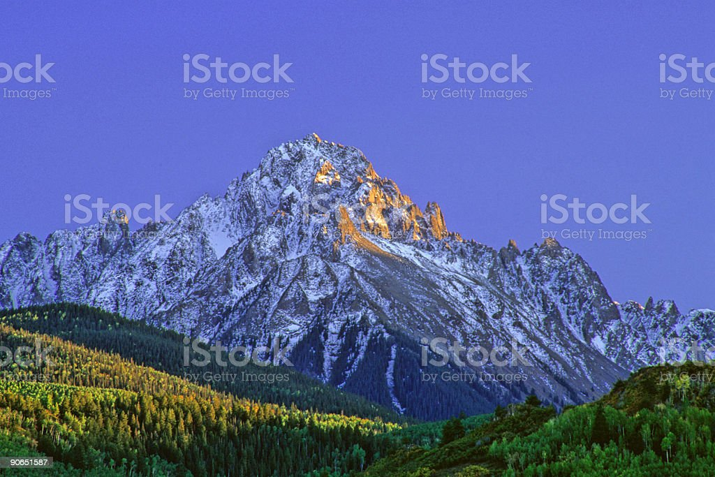 mountain landscape sunset with snow and aspen trees stock photo
