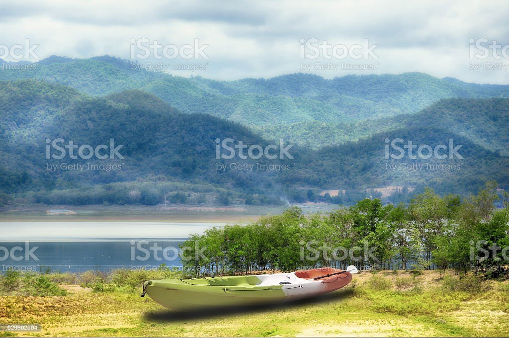 Mountain landscape view with kayak boat stock photo