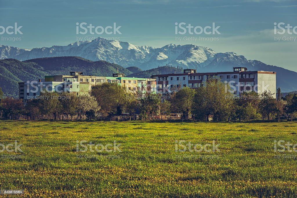 Mountain landscape with block of flats stock photo