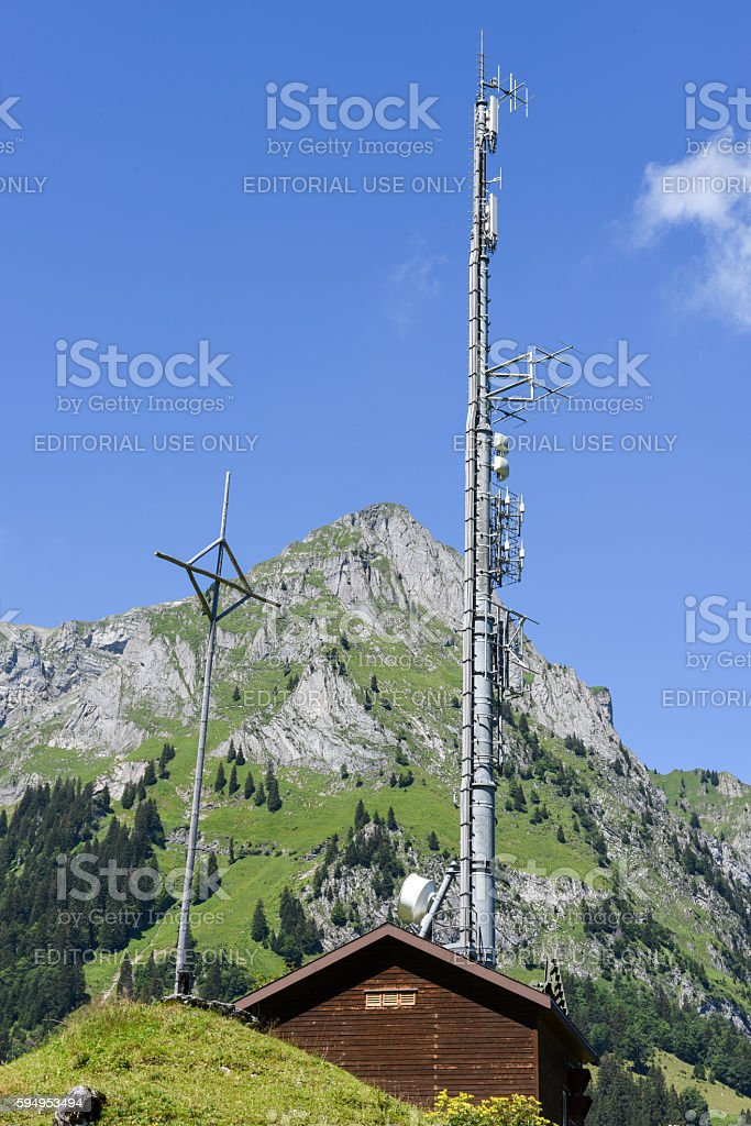 Mountain landscape with communication antenna over Engelberg stock photo