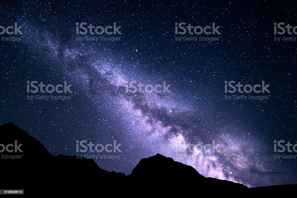Mountain landscape with Milky Way. Night starry sky stock photo