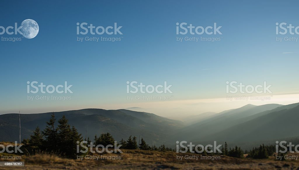 Mountain landscape with moonrise. Foggy day. stock photo