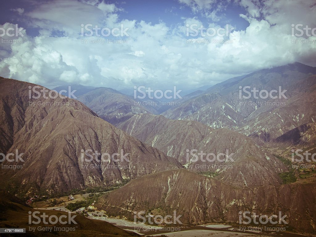 mountain landscape with river canyon and rain clouds, south america stock photo