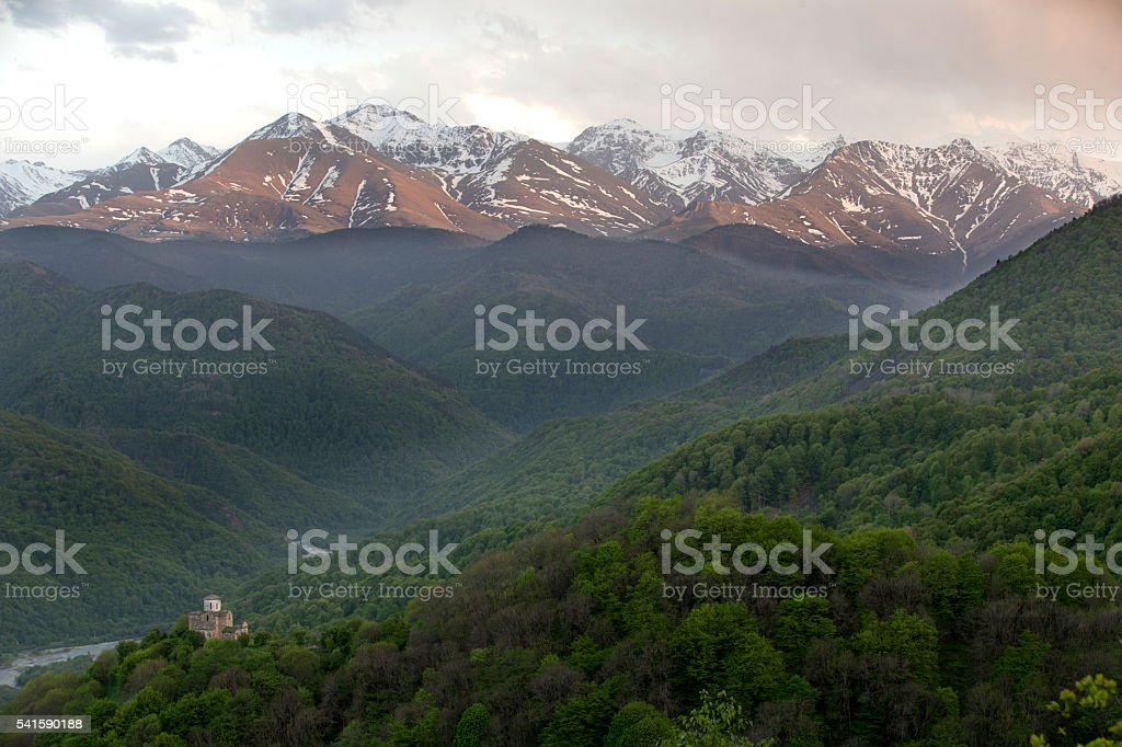Mountain landscape with the old church, Russia, Caucasus. stock photo