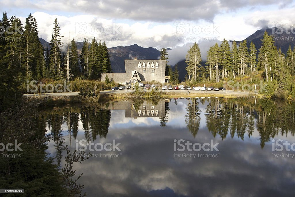 Mountain Lodge Reflected In Lake royalty-free stock photo