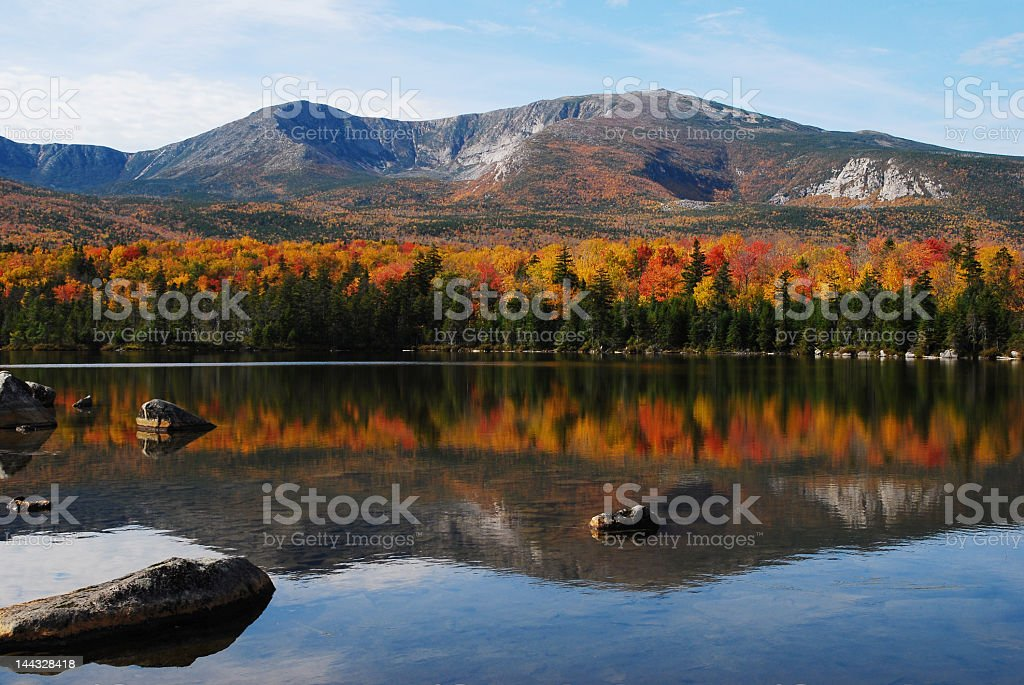 A mountain looking over a lake in autumn in Maine stock photo
