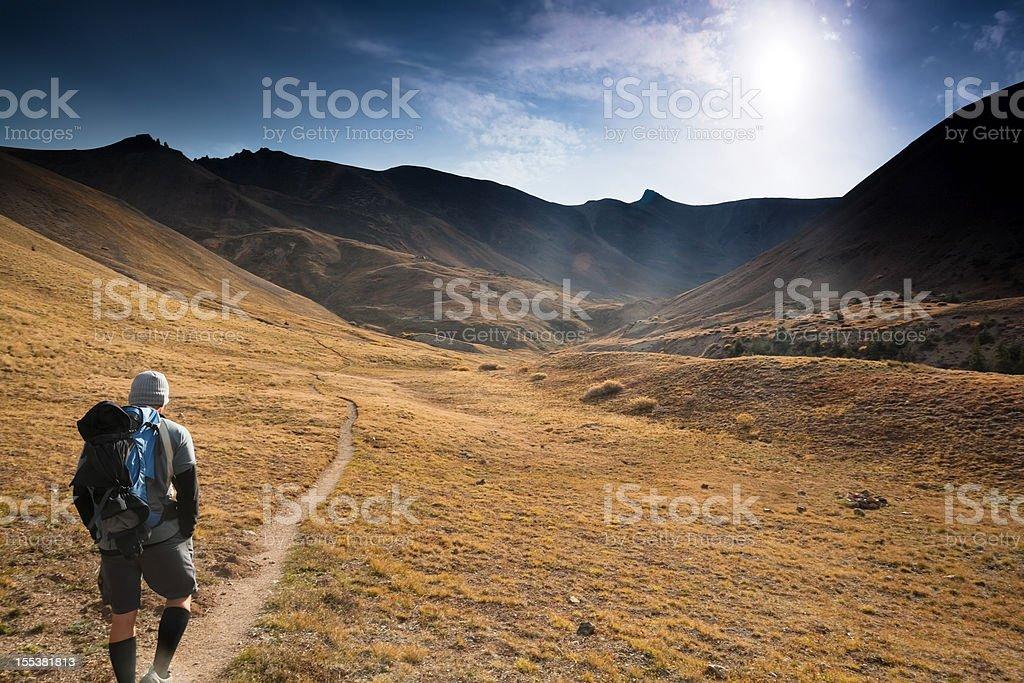 mountain man hiking sunshine landscape stock photo