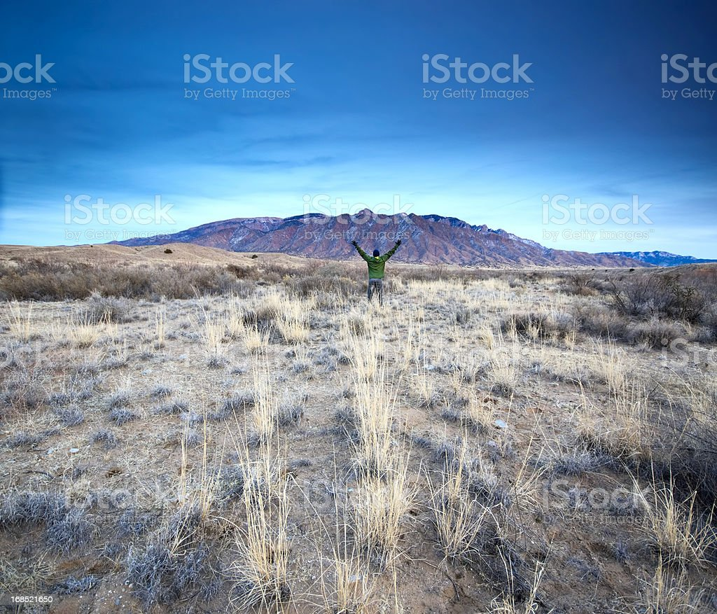 mountain man landscape sunset arms raised royalty-free stock photo