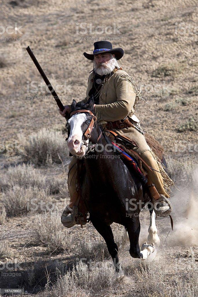 Mountain man on horse stock photo