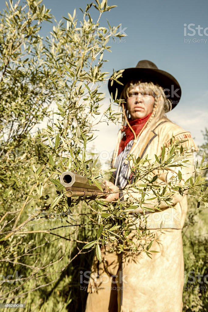 Mountain Man with Rifle in the Wild West royalty-free stock photo