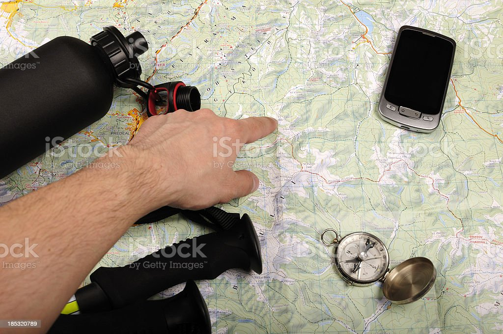 Mountain map and compass royalty-free stock photo