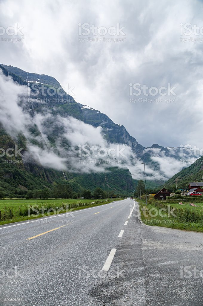 Mountain misty landscape with road stock photo