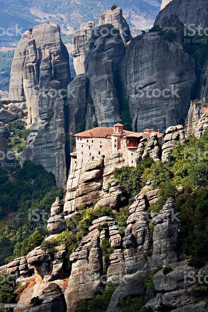 Mountain monastery on the rocks in Meteora, Greece stock photo