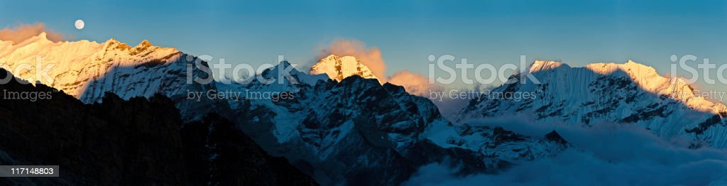 Mountain moon sunset golden snow peaks panorama Himalayas Nepal stock photo