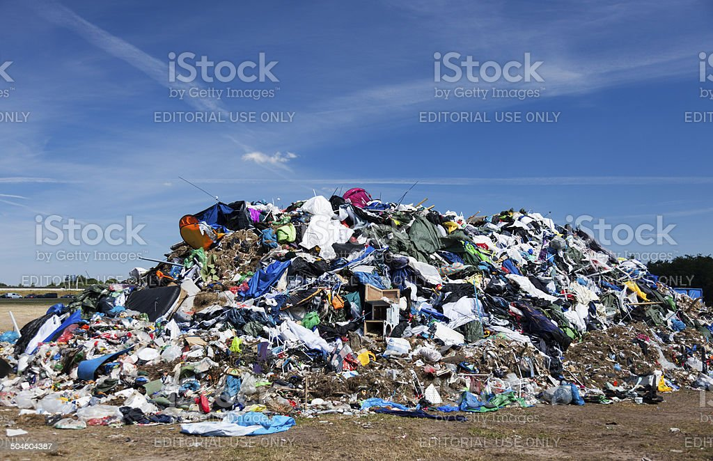 Mountain of garbage after music festival. stock photo