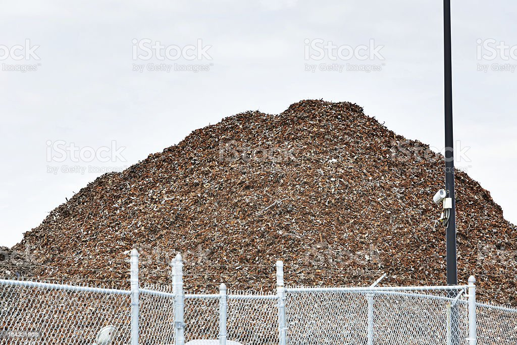 Mountain of Shredded Scrap Metal at Recycling Center royalty-free stock photo