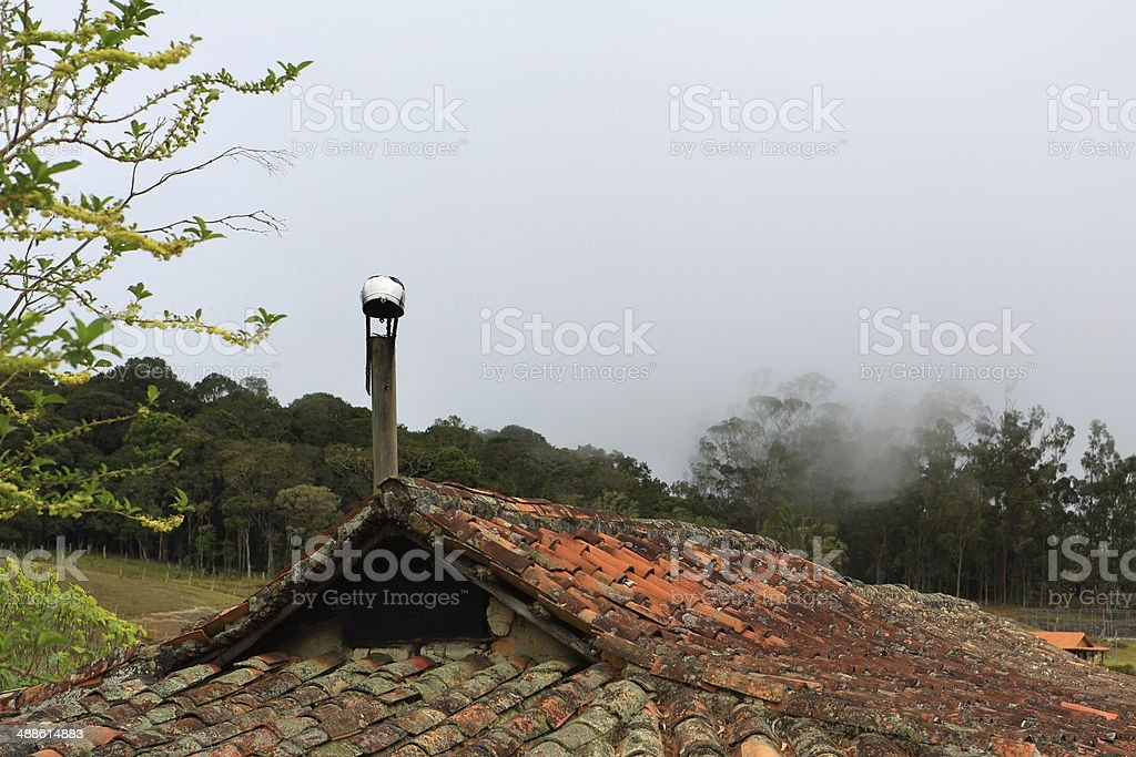Mountain Old House Roof and Chimney stock photo