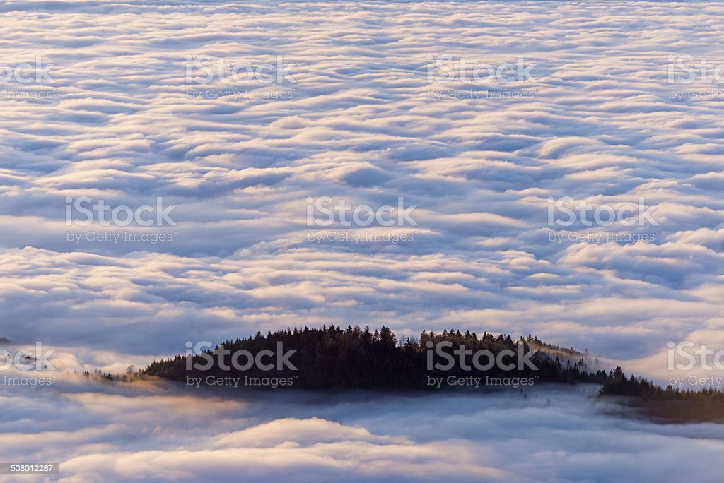 Mountain over the clouds stock photo
