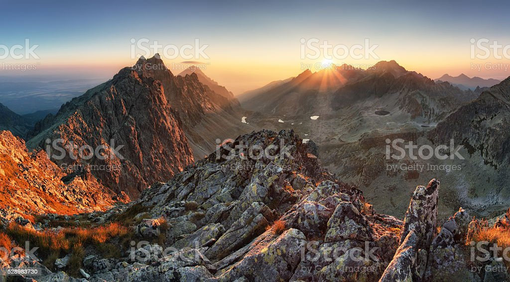Mountain panorama with sun in Slovakia stock photo
