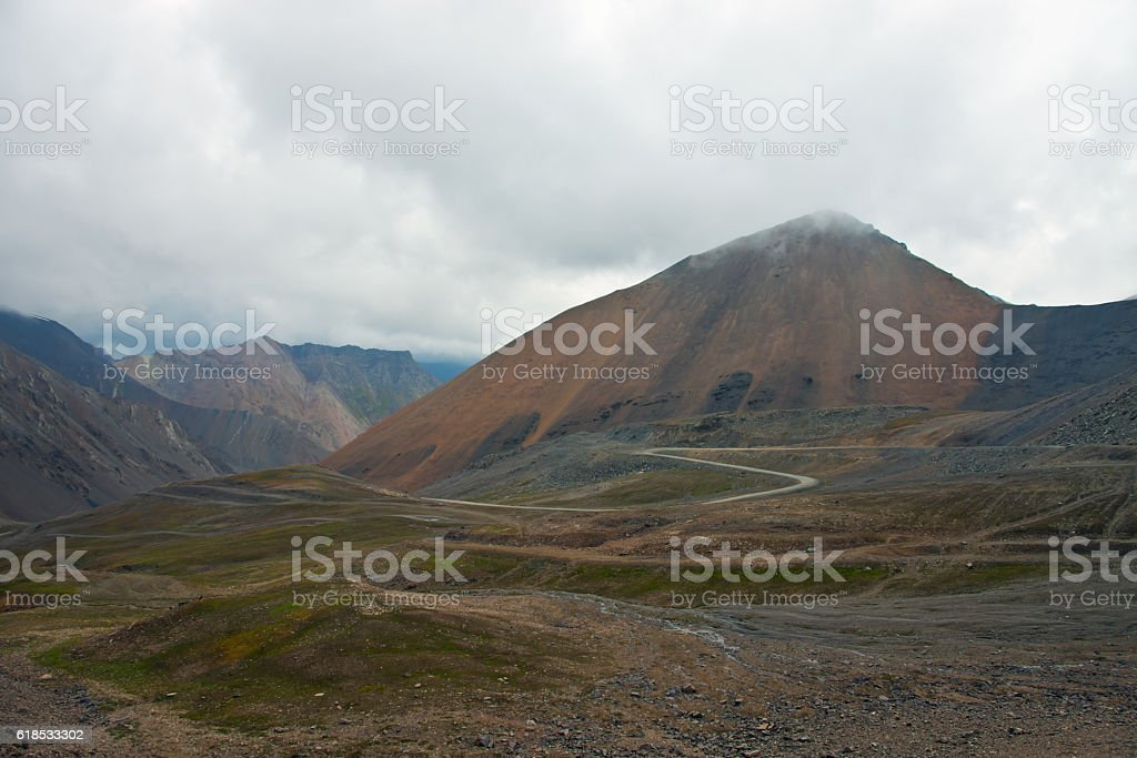 Mountain pass and the serpentine roads in the Tien Shan stock photo