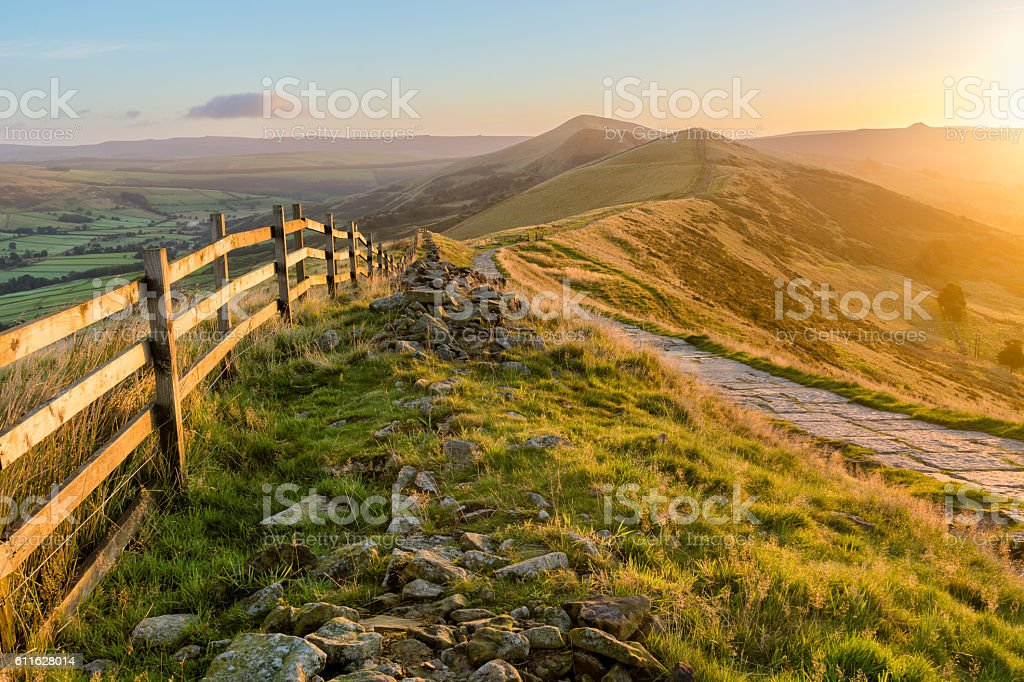 Mountain Path Bathed In Golden Sunlight. stock photo
