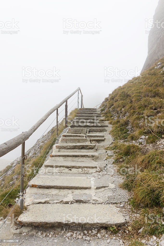 mountain path stairs of pilatus in the morning fog. stock photo
