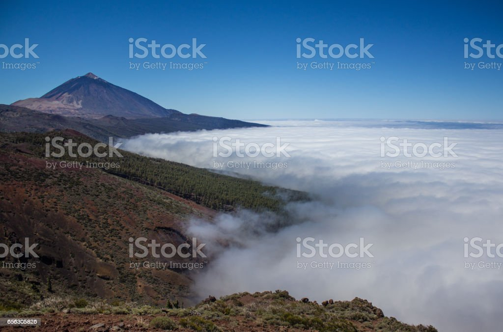 mountain peak above clouds landscape stock photo