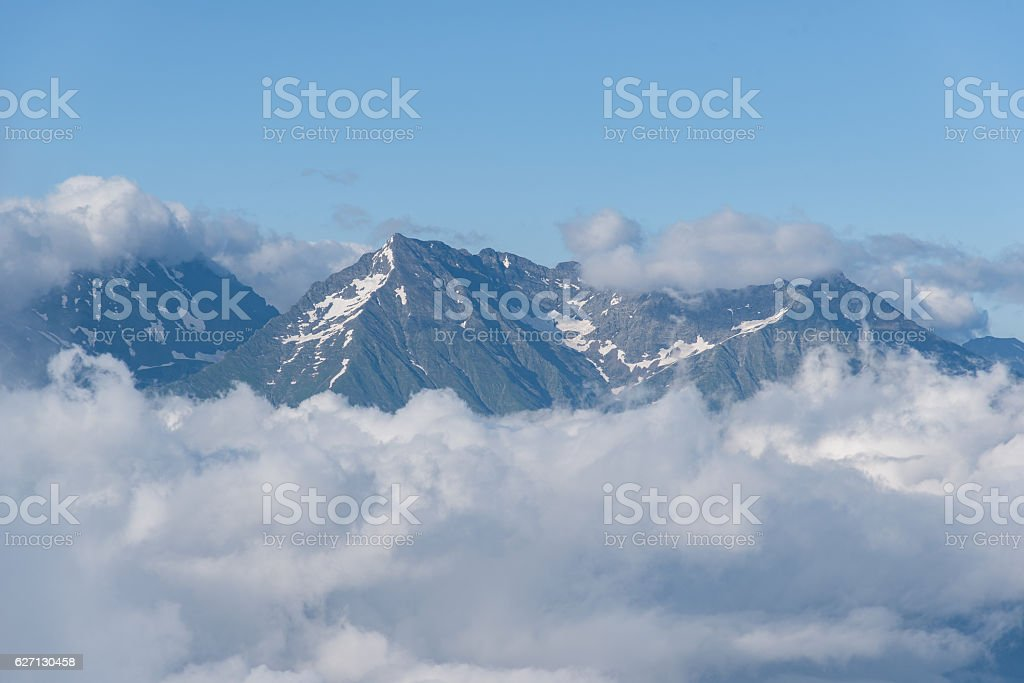 Mountain peak in the clouds Rosa Khutor stock photo