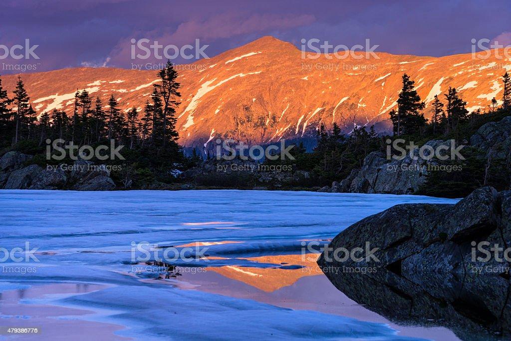 Mountain Peak Reflections at Sunset stock photo