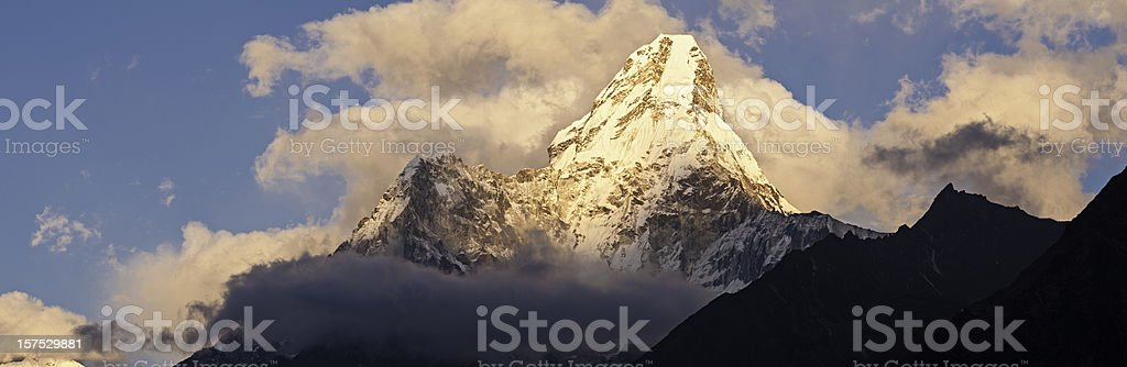 Mountain peak sunset panorama Ama Dablam Sagarmatha NP Himalaya Nepal stock photo