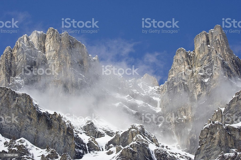 Mountain peak with clouds and snow stock photo